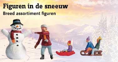 Noch figuren in de sneeuw